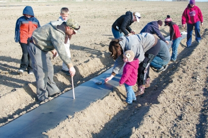 Families learning farm skills