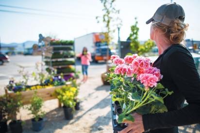 Elisa Nicole Clark holding flowers