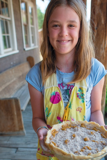 Girl holding a pie