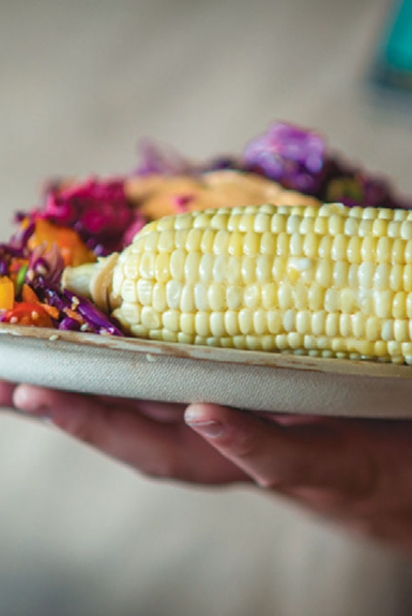 A plate with corn and other food